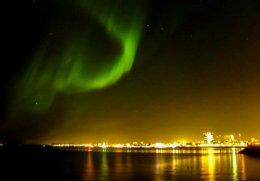 """Aurora Borealis lights up Reykjavik."""