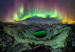 Northern Lights reflected in Kerid Volcanic Crater Lake, Iceland.